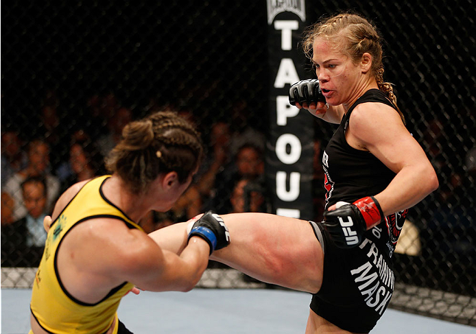 BRISBANE, AUSTRALIA - DECEMBER 07:  (R-L) Julie Kedzie kicks Bethe Correia in their women's bantamweight fight during the UFC Fight Night event at the Brisbane Entertainment Centre on December 7, 2013 in Brisbane, Australia. (Photo by Josh Hedges/Zuffa LLC/Zuffa LLC via Getty Images)