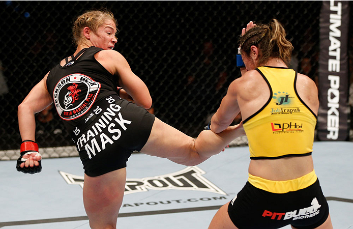 BRISBANE, AUSTRALIA - DECEMBER 07:  (L-R) Julie Kedzie kicks Bethe Correia in their women's bantamweight fight during the UFC Fight Night event at the Brisbane Entertainment Centre on December 7, 2013 in Brisbane, Australia. (Photo by Josh Hedges/Zuffa LLC/Zuffa LLC via Getty Images)