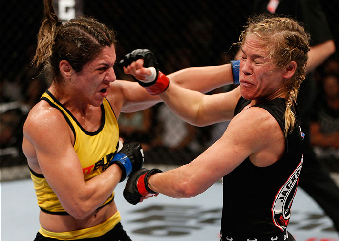 BRISBANE, AUSTRALIA - DECEMBER 07:  (L-R) Bethe Correia punches Julie Kedzie in their women's bantamweight fight during the UFC Fight Night event at the Brisbane Entertainment Centre on December 7, 2013 in Brisbane, Australia. (Photo by Josh Hedges/Zuffa LLC/Zuffa LLC via Getty Images)