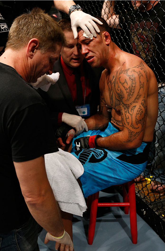 BRISBANE, AUSTRALIA - DECEMBER 07:  Dylan Andrews is treated by a doctor in his corner after suffering a shoulder injury during round two of his middleweight fight against Clint Hester during the UFC Fight Night event at the Brisbane Entertainment Centre on December 7, 2013 in Brisbane, Australia. (Photo by Josh Hedges/Zuffa LLC/Zuffa LLC via Getty Images)
