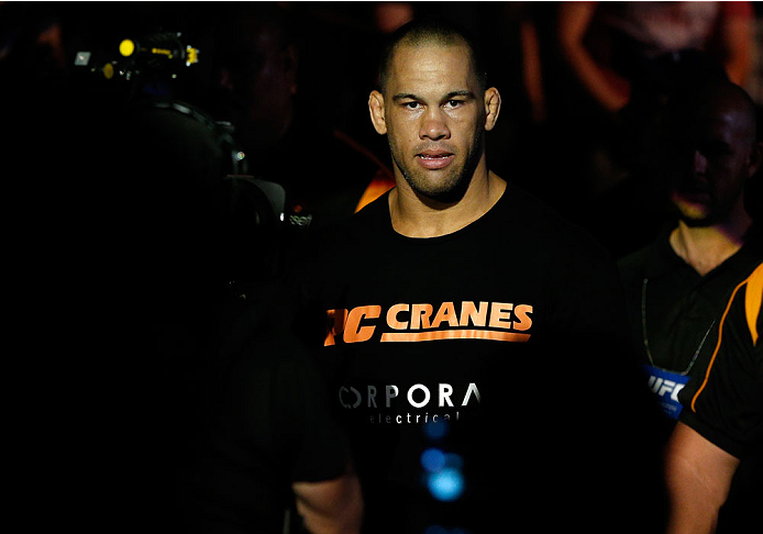 "BRISBANE, AUSTRALIA - DECEMBER 07:  James Te Huna enters the arena before his light heavyweight fight against Mauricio ""Shogun"" Rua during the UFC Fight Night event at the Brisbane Entertainment Centre on December 7, 2013 in Brisbane, Australia. (Photo by Josh Hedges/Zuffa LLC/Zuffa LLC via Getty Images)"