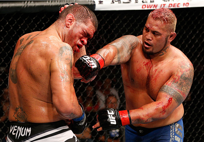 "BRISBANE, AUSTRALIA - DECEMBER 07:  (R-L) Mark Hunt punches Antonio ""Bigfoot"" Silva in their heavyweight fight during the UFC Fight Night event at the Brisbane Entertainment Centre on December 7, 2013 in Brisbane, Australia. (Photo by Josh Hedges/Zuffa LLC/Zuffa LLC via Getty Images)"