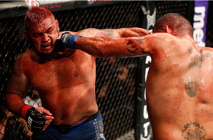 "BRISBANE, AUSTRALIA - DECEMBER 07:  (L-R) Mark Hunt and Antonio ""Bigfoot"" Silva trade punches in their heavyweight fight during the UFC Fight Night event at the Brisbane Entertainment Centre on December 7, 2013 in Brisbane, Australia. (Photo by Josh Hedges/Zuffa LLC/Zuffa LLC via Getty Images)"