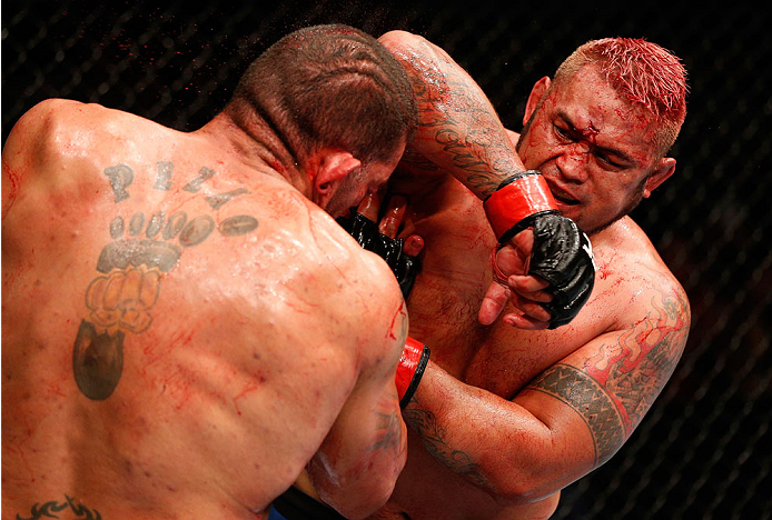 "BRISBANE, AUSTRALIA - DECEMBER 07:  (R-L) Mark Hunt elbows Antonio ""Bigfoot"" Silva in their heavyweight fight during the UFC Fight Night event at the Brisbane Entertainment Centre on December 7, 2013 in Brisbane, Australia. (Photo by Josh Hedges/Zuffa LLC/Zuffa LLC via Getty Images)"