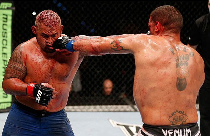 "BRISBANE, AUSTRALIA - DECEMBER 07:  (R-L) Antonio ""Bigfoot"" Silva and Mark Hunt trade punches in their heavyweight fight during the UFC Fight Night event at the Brisbane Entertainment Centre on December 7, 2013 in Brisbane, Australia. (Photo by Josh Hedges/Zuffa LLC/Zuffa LLC via Getty Images)"