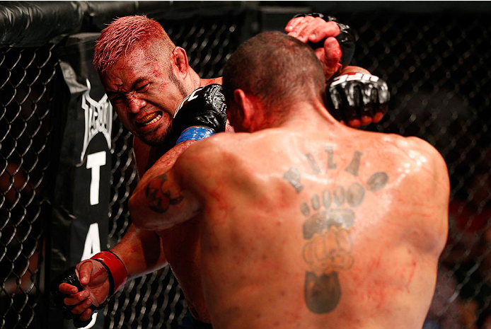"BRISBANE, AUSTRALIA - DECEMBER 07:  (L-R) Mark Hunt punches Antonio ""Bigfoot"" Silva in their heavyweight fight during the UFC Fight Night event at the Brisbane Entertainment Centre on December 7, 2013 in Brisbane, Australia. (Photo by Josh Hedges/Zuffa LLC/Zuffa LLC via Getty Images)"