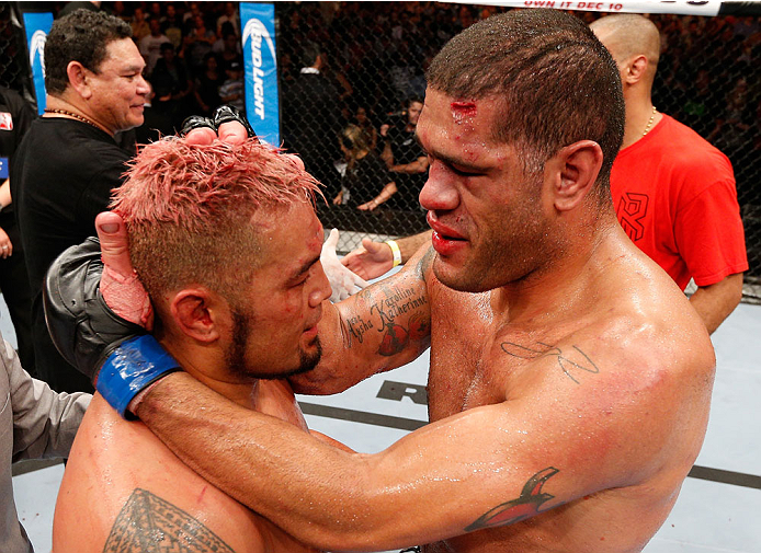 "BRISBANE, AUSTRALIA - DECEMBER 07:  (R-L) Opponents Antonio ""Bigfoot"" Silva and Mark Hunt congratulate one another after their five-round heavyweight fight during the UFC Fight Night event at the Brisbane Entertainment Centre on December 7, 2013 in Brisbane, Australia. (Photo by Josh Hedges/Zuffa LLC/Zuffa LLC via Getty Images)"