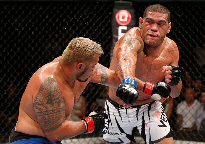 "BRISBANE, AUSTRALIA - DECEMBER 07:  (R-L) Antonio ""Bigfoot"" Silva punches Mark Hunt in their heavyweight fight during the UFC Fight Night event at the Brisbane Entertainment Centre on December 7, 2013 in Brisbane, Australia. (Photo by Josh Hedges/Zuffa LLC/Zuffa LLC via Getty Images)"