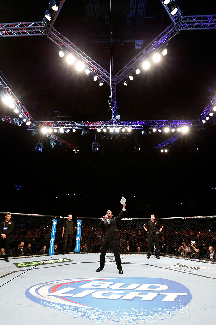 BRISBANE, AUSTRALIA - DECEMBER 07:  Octagon announcer Bruce Buffer introduces the main event fighters during the UFC Fight Night event at the Brisbane Entertainment Centre on December 7, 2013 in Brisbane, Australia. (Photo by Josh Hedges/Zuffa LLC/Zuffa LLC via Getty Images)
