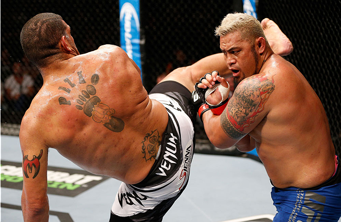 "BRISBANE, AUSTRALIA - DECEMBER 07:  (L-R) Antonio ""Bigfoot"" Silva kicks Mark Hunt in their heavyweight fight during the UFC Fight Night event at the Brisbane Entertainment Centre on December 7, 2013 in Brisbane, Australia. (Photo by Josh Hedges/Zuffa LLC/Zuffa LLC via Getty Images)"