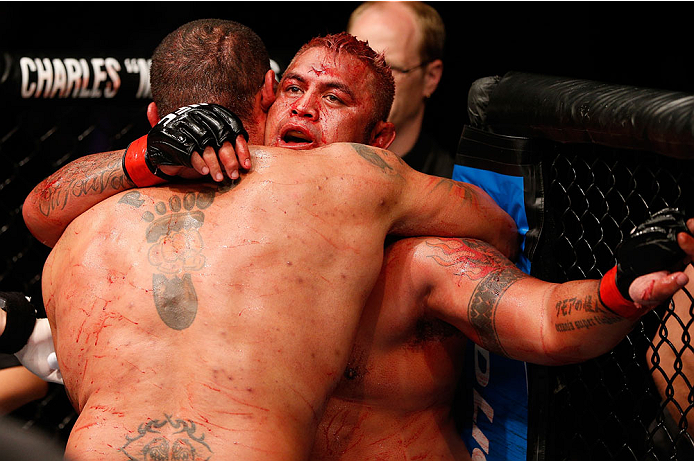 BRISBANE, AUSTRALIA - DECEMBER 07:  (R-L) Opponents Mark Hunt and Antonio Silva hug after their five round battle during the UFC Fight Night event at the Brisbane Entertainment Centre on December 7, 2013 in Brisbane, Australia. (Photo by Josh Hedges/Zuffa LLC/Zuffa LLC via Getty Images)