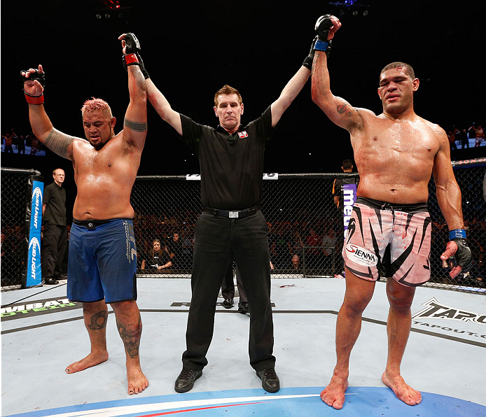 "BRISBANE, AUSTRALIA - DECEMBER 07:  The heavyweight fight between Mark Hunt (L) and Antonio ""Bigfoot"" Silva (R) is declared a majority draw during the UFC Fight Night event at the Brisbane Entertainment Centre on December 7, 2013 in Brisbane, Australia. (Photo by Josh Hedges/Zuffa LLC/Zuffa LLC via Getty Images)"