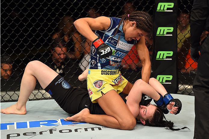 FAIRFAX, VA - APRIL 04: (L-R) Juliana Pena punches Milana Dudieva on the ground in their women's bantamweight fight during the UFC Fight Night event at the Patriot Center on April 4, 2015 in Fairfax, Virginia. (Photo by Josh Hedges/Zuffa LLC/Zuffa LLC via Getty Images)