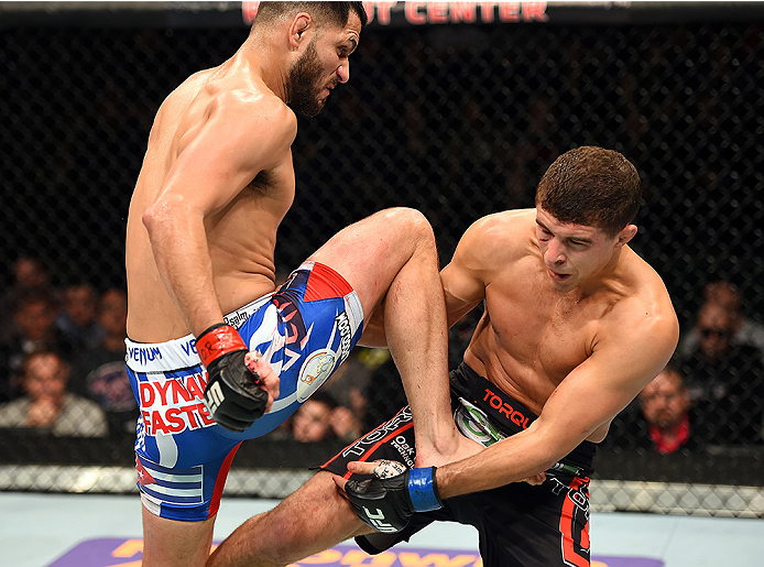 FAIRFAX, VA - APRIL 04:  (L-R) Jorge Masvidal throws a flying knee against Al Iaquinta in their lightweight fight during the UFC Fight Night event at the Patriot Center on April 4, 2015 in Fairfax, Virginia. (Photo by Josh Hedges/Zuffa LLC/Zuffa LLC via Getty Images)
