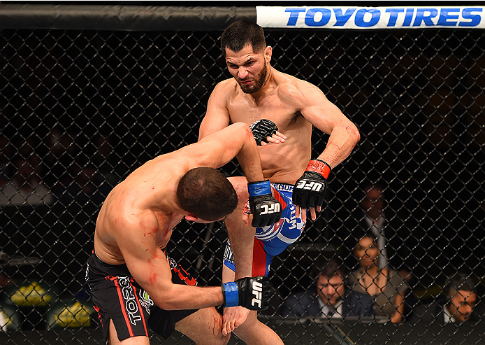FAIRFAX, VA - APRIL 04:  (R-L) Jorge Masvidal lands a knee to the head of Al Iaquinta in their lightweight fight during the UFC Fight Night event at the Patriot Center on April 4, 2015 in Fairfax, Virginia. (Photo by Josh Hedges/Zuffa LLC/Zuffa LLC via Getty Images)