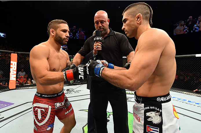 FAIRFAX, VA - APRIL 04: (L-R) Chad Mendes and Ricardo Lamas touch gloves before in their featherweight fight during the UFC Fight Night event at the Patriot Center on April 4, 2015 in Fairfax, Virginia. (Photo by Josh Hedges/Zuffa LLC/Zuffa LLC via Getty Images)