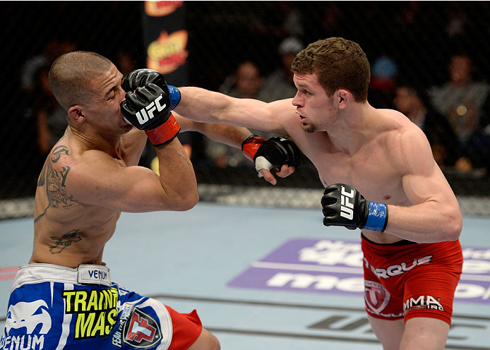 DULUTH, GA - JANUARY 15: (R-L) Dustin Ortiz punches John Moraga in their flyweight fight during the UFC Fight Night event inside The Arena at Gwinnett Center on January 15, 2014 in Duluth, Georgia.  (Photo by Jeff Bottari/Zuffa LLC/Zuffa LLC via Getty Images)