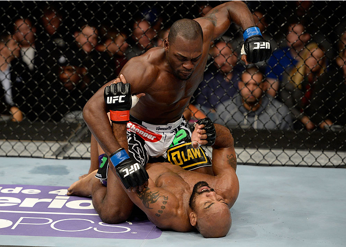 DULUTH, GA - JANUARY 15: Derek Brunson (Top) battles Yoel Romero on the mat in their middleweight fight during the UFC Fight Night event inside The Arena at Gwinnett Center on January 15, 2014 in Duluth, Georgia. (Photo by Jeff Bottari/Zuffa LLC/Zuffa LLC via Getty Images)