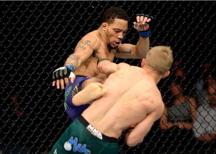 DULUTH, GA - JANUARY 15: (L-R) Mike Easton kicks TJ Dillashaw in their bantamweight fight during the UFC Fight Night event inside The Arena at Gwinnett Center on January 15, 2014 in Duluth, Georgia. (Photo by Jeff Bottari/Zuffa LLC/Zuffa LLC via Getty Images)