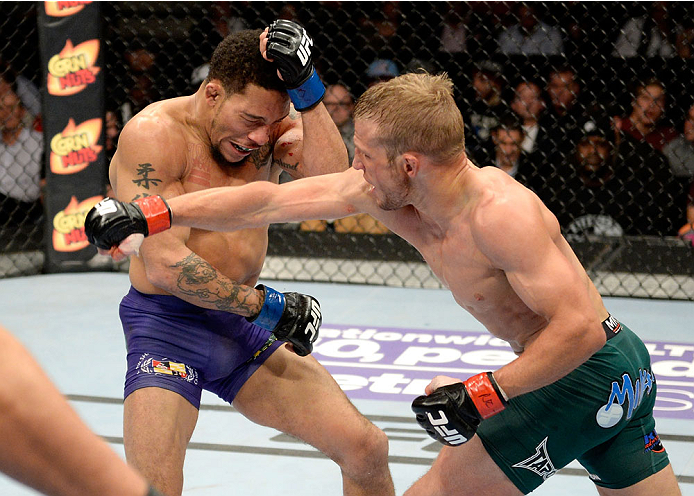 DULUTH, GA - JANUARY 15: (R-L) TJ Dillashaw punches Mike Easton in their bantamweight fight during the UFC Fight Night event inside The Arena at Gwinnett Center on January 15, 2014 in Duluth, Georgia. (Photo by Jeff Bottari/Zuffa LLC/Zuffa LLC via Getty Images)