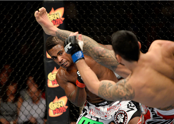 DULUTH, GA - JANUARY 15: (L-R) Lorenz Larkin ducks under a kick by Brad Tavares in their middleweight fight during the UFC Fight Night event inside The Arena at Gwinnett Center on January 15, 2014 in Duluth, Georgia. (Photo by Jeff Bottari/Zuffa LLC/Zuffa LLC via Getty Images)