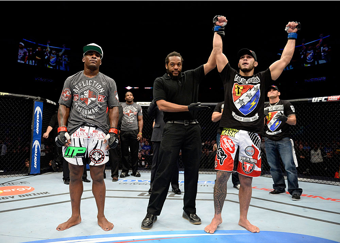 DULUTH, GA - JANUARY 15: (R-L) Brad Tavares reacts after winning the decision over Lorenz Larkin in their middleweight fight during the UFC Fight Night event inside The Arena at Gwinnett Center on January 15, 2014 in Duluth, Georgia. (Photo by Jeff Bottari/Zuffa LLC/Zuffa LLC via Getty Images)