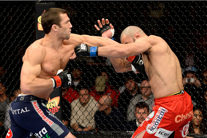 DULUTH, GA - JANUARY 15: (L-R) Luke Rockhold punches Costas Philippou in their middleweight fight during the UFC Fight Night event inside The Arena at Gwinnett Center on January 15, 2014 in Duluth, Georgia. (Photo by Jeff Bottari/Zuffa LLC/Zuffa LLC via Getty Images)
