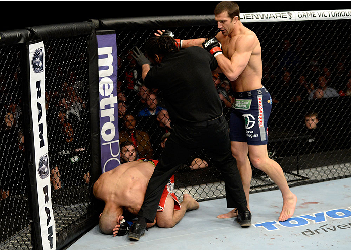 DULUTH, GA - JANUARY 15: (R-L) Luke Rockhold reacts after his TKO victory over Costas Philippou in their middleweight fight during the UFC Fight Night event inside The Arena at Gwinnett Center on January 15, 2014 in Duluth, Georgia. (Photo by Jeff Bottari/Zuffa LLC/Zuffa LLC via Getty Images)