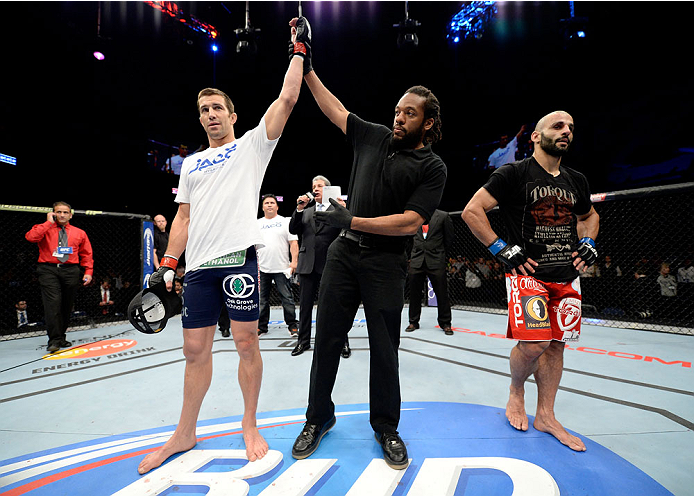 DULUTH, GA - JANUARY 15: (L-R) Luke Rockhold reacts after his TKO victory over Costas Philippou in their middleweight fight during the UFC Fight Night event inside The Arena at Gwinnett Center on January 15, 2014 in Duluth, Georgia. (Photo by Jeff Bottari/Zuffa LLC/Zuffa LLC via Getty Images)