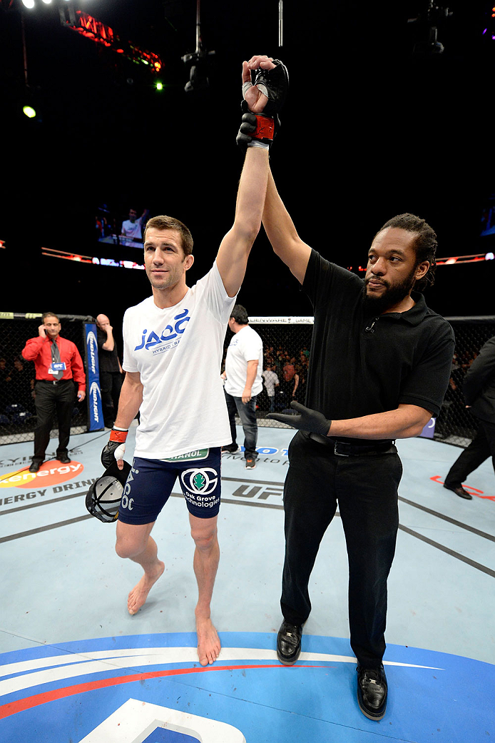 DULUTH, GA - JANUARY 15:  Luke Rockhold reacts after his TKO victory over Costas Philippou in their middleweight fight during the UFC Fight Night event inside The Arena at Gwinnett Center on January 15, 2014 in Duluth, Georgia. (Photo by Jeff Bottari/Zuffa LLC/Zuffa LLC via Getty Images)