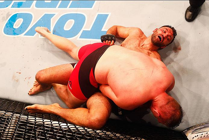 HAMBURG, GERMANY - SEPTEMBER 03:  Josh Barnett (top) of USA controls the body of  Andrei Arlovski  of Belarus compete in their Heavyweight Bout during the UFC Fight Night held at Barclaycard Arena  at Barclaycard Arena on September 3, 2016 in Hamburg, Germany.  (Photo by Dean Mouhtaropoulos/Zuffa LLC/Zuffa LLC via Getty Images)