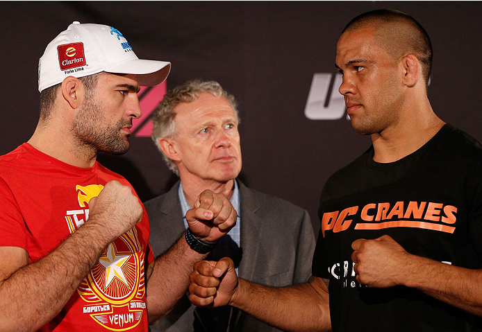 "BRISBANE, AUSTRALIA - DECEMBER 05:  (L-R) Opponents Mauricio ""Shogun"" Rua and James Te Huna face off during the UFC Ultimate Media Day at the Brisbane Marriott Hotel on December 5, 2013 in Brisbane, Australia. (Photo by Josh Hedges/Zuffa LLC/Zuffa LLC via Getty Images)"