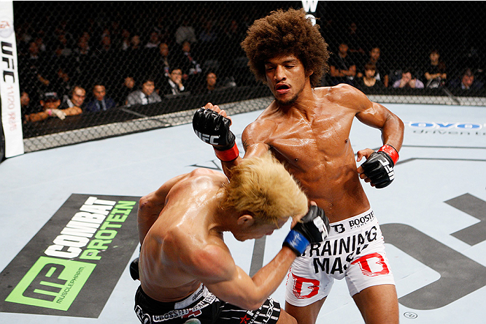 SAITAMA, JAPAN - SEPTEMBER 20:  Alex Caceres and Masanori Kanehara exchange a fury of punches in their bantamweight bout during the UFC Fight Night event inside the Saitama Arena on September 20, 2014 in Saitama, Japan. (Photo by Mitch Viquez/Zuffa LLC/Zuffa LLC via Getty Images)