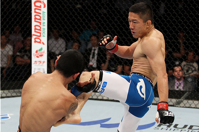 Horiguchi throws a leg kick at Jon Delos Reyes