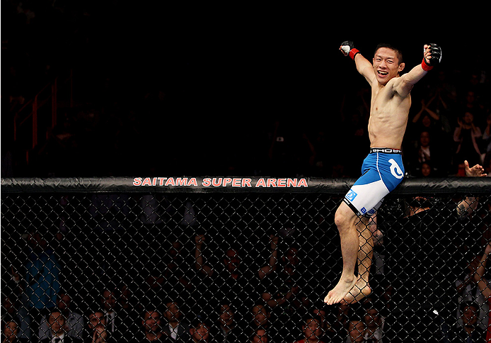 SAITAMA, JAPAN - SEPTEMBER 20: Kyoji Horiguchi celebrates his win over  Jon Delos Reyes in their flyweight bout during the UFC Fight Night event inside the Saitama Arena on September 20, 2014 in Saitama, Japan. (Photo by Mitch Viquez/Zuffa LLC/Zuffa LLC via Getty Images)