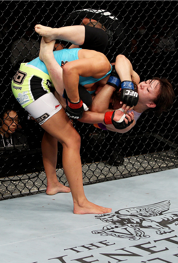 SAITAMA, JAPAN - SEPTEMBER 20:  Rin Nakai hangs from Miesha Tate in their bantamweight bout during the UFC Fight Night event inside the Saitama Arena on September 20, 2014 in Saitama, Japan. (Photo by Mitch Viquez/Zuffa LLC/Zuffa LLC via Getty Images)