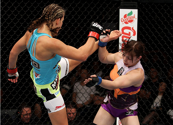 SAITAMA, JAPAN - SEPTEMBER 20: Miesha Tate throws a kick at Rin Nakai in their bantamweight bout during the UFC Fight Night event inside the Saitama Arena on September 20, 2014 in Saitama, Japan. (Photo by Mitch Viquez/Zuffa LLC/Zuffa LLC via Getty Images)