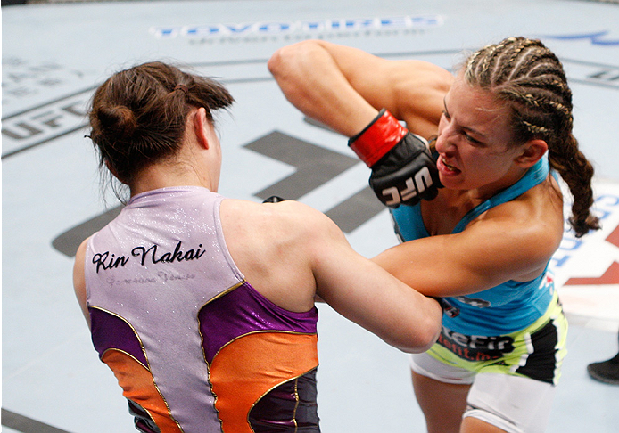 SAITAMA, JAPAN - SEPTEMBER 20:  Miesha Tate throws an elbow at Rin Nakai in their bantamweight bout during the UFC Fight Night event inside the Saitama Arena on September 20, 2014 in Saitama, Japan. (Photo by Mitch Viquez/Zuffa LLC/Zuffa LLC via Getty Images)