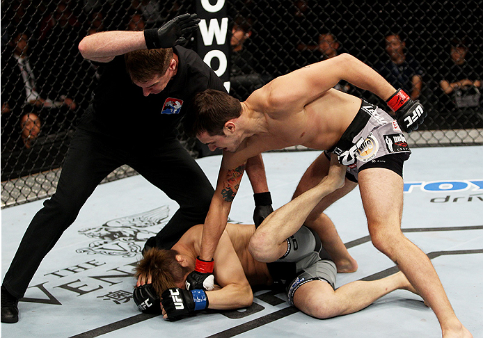 Myles Jury (right) stops Gomi