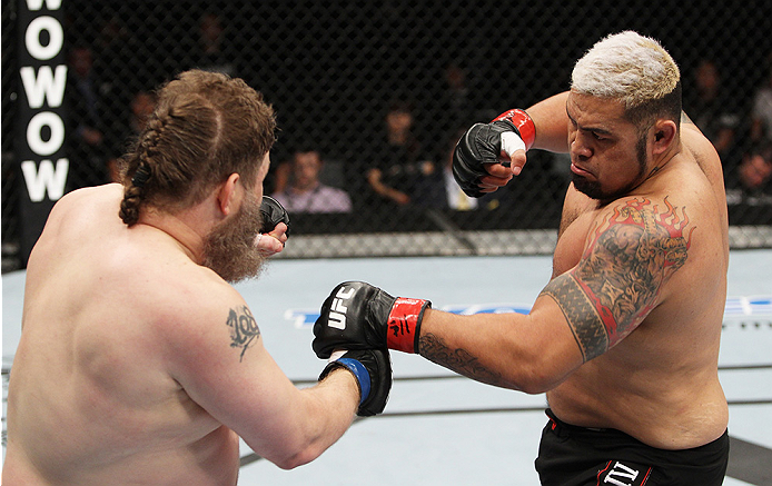 SAITAMA, JAPAN - SEPTEMBER 20:  Mark Hunt loads up to throw a punch on Roy Nelson in their heavyweight bout during the UFC Fight Night event inside the Saitama Arena on September 20, 2014 in Saitama, Japan. (Photo by Mitch Viquez/Zuffa LLC/Zuffa LLC via Getty Images)