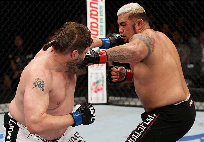 SAITAMA, JAPAN - SEPTEMBER 20: Roy Nelson punches Mark Hunt in their heavyweight bout during the UFC Fight Night event inside the Saitama Arena on September 20, 2014 in Saitama, Japan. (Photo by Mitch Viquez/Zuffa LLC/Zuffa LLC via Getty Images)
