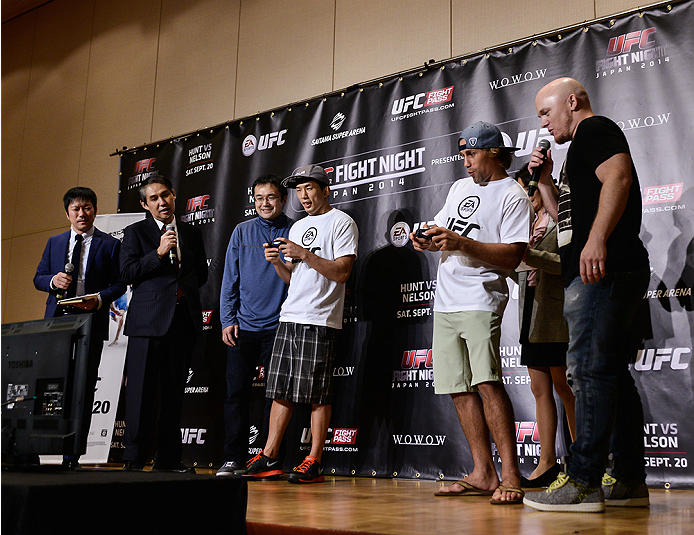 TOKYO, JAPAN - SEPTEMBER 17:  Takeya Mizugaki and Urijah Faber (White T-Shirt) play the new EA UFC video game during the UFC Ultimate Media Day at the Hilton Tokyo on September 17, 2014 in Tokyo, Japan.  (Photo by Keith Tsuji/Zuffa LLC/Zuffa LLC via Getty Images)