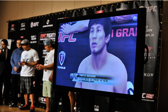 TOKYO, JAPAN - SEPTEMBER 17:  New EA UFC video game character of Takeya Mizugaki is seen on screen during the UFC Ultimate Media Day at the Hilton Tokyo on September 17, 2014 in Tokyo, Japan.  (Photo by Keith Tsuji/Zuffa LLC/Zuffa LLC via Getty Images)