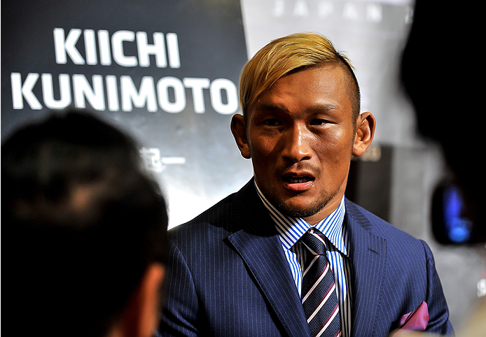 TOKYO, JAPAN - SEPTEMBER 17:  Kiichi Kunimoto interacts with media during the UFC Ultimate Media Day at the Hilton Tokyo on September 17, 2014 in Tokyo, Japan.  (Photo by Keith Tsuji/Zuffa LLC/Zuffa LLC via Getty Images)