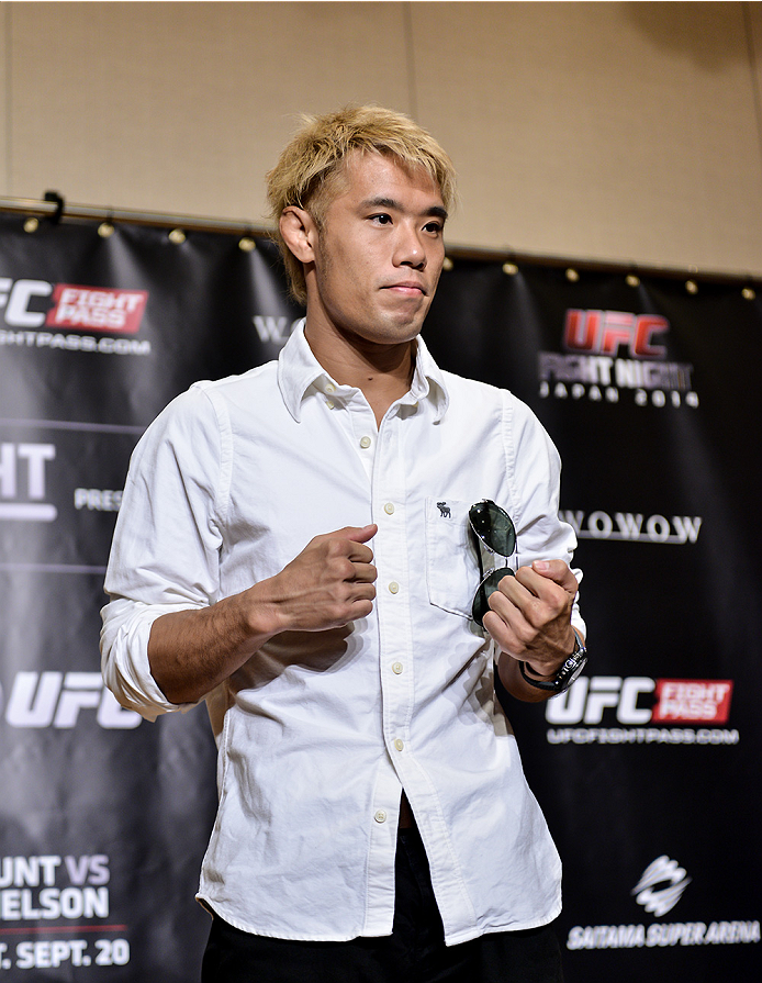 TOKYO, JAPAN - SEPTEMBER 17:  Masanori Kanehara interacts with media during the UFC Ultimate Media Day at the Hilton Tokyo on September 17, 2014 in Tokyo, Japan.  (Photo by Keith Tsuji/Zuffa LLC/Zuffa LLC via Getty Images)