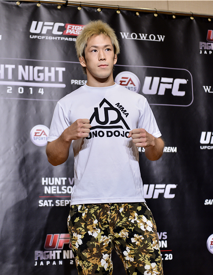 TOKYO, JAPAN - SEPTEMBER 17:  Michinori Tanaka interacts with media during the UFC Ultimate Media Day at the Hilton Tokyo on September 17, 2014 in Tokyo, Japan.  (Photo by Keith Tsuji/Zuffa LLC/Zuffa LLC via Getty Images)