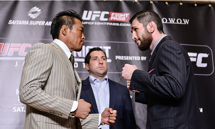 TOKYO, JAPAN - SEPTEMBER 17:  Yoshihiro Akiyama (L) and Amir Sadollah square off for the media during the UFC Ultimate Media Day at the Hilton Tokyo on September 17, 2014 in Tokyo, Japan.  (Photo by Keith Tsuji/Zuffa LLC/Zuffa LLC via Getty Images)