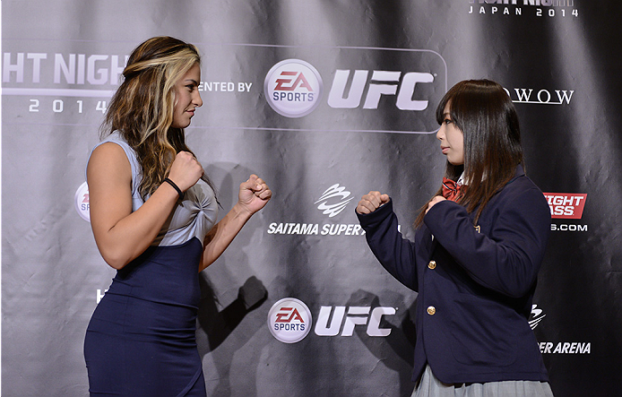 TOKYO, JAPAN - SEPTEMBER 17:  Miesha Tate (L) and Rin Nakai square off for the media during the UFC Ultimate Media Day at the Hilton Tokyo on September 17, 2014 in Tokyo, Japan.  (Photo by Keith Tsuji/Zuffa LLC/Zuffa LLC via Getty Images)
