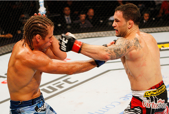 MANILA, PHILIPPINES - MAY 16: Frankie Edgar of the United States throws a punch at Uriah Faber of the United States in their featherweight fight during the UFC Fight Night event at the Mall of Asia Arena on May 16, 2015 in Manila, Philippines. (Photo by Mitch Viquez/Zuffa LLC/Zuffa LLC via Getty Images)