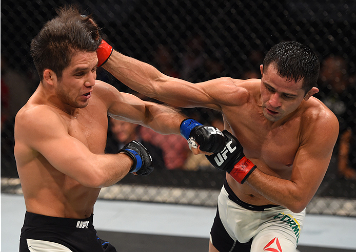 MONTERREY, MEXICO - NOVEMBER 21:  (R-L) Jussier Formiga of Brazil punches Henry Cejudo of the United States in their flyweight bout during the UFC Fight Night event at Arena Monterrey on November 21, 2015 in Monterrey, Mexico.  (Photo by Jeff Bottari/Zuffa LLC/Zuffa LLC via Getty Images)